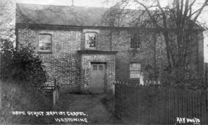 The old Chapel early in the 20th century following the addition of gallery stairs and porch